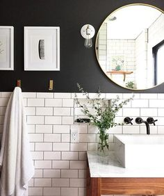 Classic bathroom. Love there white subway tile and black wall paint for a small bathroom #smallbathroom #subwaytile