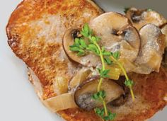 Pork Fricassee: A quick, rich pan sauce with Greek yogurt updates a farmhouse classic of pan-fried pork chops, mushrooms and onions.