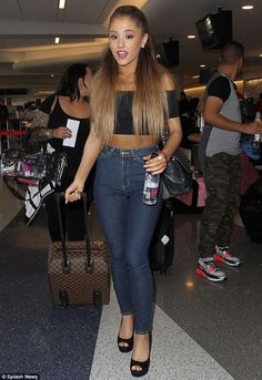Ariana Grande's fake tan fail in crop top and jeans at the airport ...
