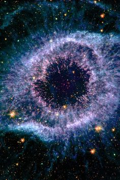 The Helix Nebula, lies 650 light-years away, in the constellation of Aquarius. It is a typical example of a class of objects called planetary nebula. Planetary nebulae are actually the remains of stars that once looked a lot like our sun. These stars spend most of their lives turning hydrogen into helium in massive runaway nuclear fusion reactions in their cores. In fact, this process of fusion provides all the light and heat that we get from our sun.
