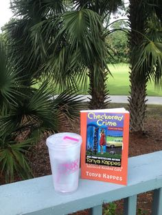Reading A Checkered Crime by the pool on Kiawah Island, SC -- With a cocktail in my Tonya Kappes cup! <3