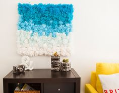 A Pom Pom Rug, Wall Hanging and Table Cover in One!