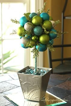 This #DIY Ornament Topiary project is a great way to dress up your mantle or front entrance for the holidays! #MoreForTheHolidays