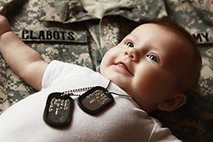 @Kati Zumwalt  Use papa's dog tags and Darin's uniform top military or police? Cute!