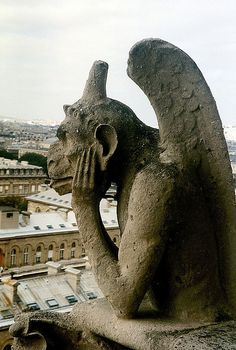 a gargoyle on the tower of Notre-Dame cathedral in Paris