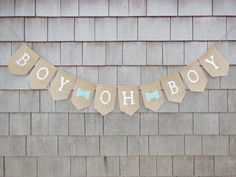This listing is for a BOY OH BOY burlap banner. Banner details: - burlap pennants each measuring 4 inches wide by 6.5 inches long. -BOY OH BOY written in all uppercase letters in white - two light blue hearts separating words -Flags are lightly treated to try to minimize fraying. -Banner is strung on twine -Total length of banner is approx. 40 inches long. - Plenty of extra twine on each end for hanging.  ** Customize this banner with the font and heart colors your choice! Hearts can also be…