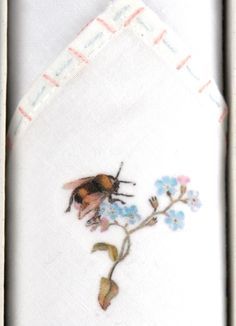 A tiny motif of a Bumble Bee is hand printed onto the Handkerchief, and the edge is then Hand embroidered with colourful threads, a needle and LOTS of patience and LOVE.