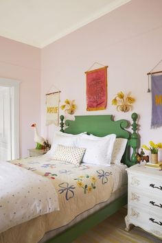 An antique quilt looks surprisingly modern when paired with graphic heart-print bedding.