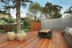 Architecture:Modern Terrace Decorating With Outdoor Kitchen Ideas And Dining Area Laminated Wooden Floor Finnis Architects Bring Us Home wit...