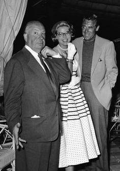 "Alfred Hitchcock, Grace Kelly and Cary Grant at a cocktail party in Cannes during the filming of ""To Catch a Thief"""
