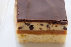Cookie Dough Billionaire Bars feature delicious layers of crust, caramel, cookie dough, and chocolate.