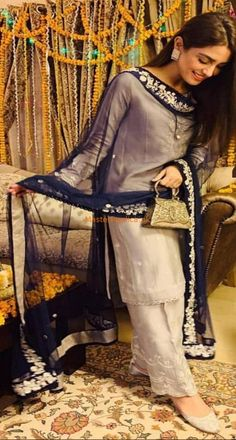 Check out this Mesmerizing Master Replica of Maya Ali Fabric: Silk Embroidered Silk Shirt Front (Hand work) Plain Silk Shirt Back Embroidered Silk Sleeves (Hand work) Embroidered Chiffon Dupatta Embroidered Silk Trousers Included Simple Pakistani Dresses, Pakistani Party Wear Dresses, Pakistani Dress Design, Pakistani Outfits, Indian Outfits, Stylish Dresses For Girls, Simple Dresses, Mahira Khan Dresses, Classic Fashion Looks