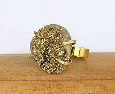Large Raw Pyrite Stone encased in Gold Plated Prong Setting atop Adjustable Band Ring