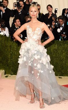 2016 Met Gala: Karolina Kurkova is elegant in a white Marchesa high/low gown with floral appliques. Elegant in white! Karolina always nails it on the Met Gala red carpet.