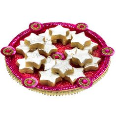 Kaju ke sitare : Cane thaali covered with exuberant jamewar fabric and adorned with sequins lace and sequin motifs. This thaali contains: Star shaped kaju katli. Net weight: 200 grams. Comes with rakhi, roli and chawal. Rs 589/- Shop Now :   http://www.tajonline.com/rakhi-gifts/product/r4530/kaju-ke-sitare/