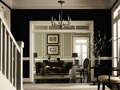 Dare to be dramatic! Greet guests in style and paint your entry a dark shade like Tricorn Black (SW 6258).