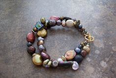 Multi Stranded Fresh Water Pearl Bracelet by dnajewelrydesigns