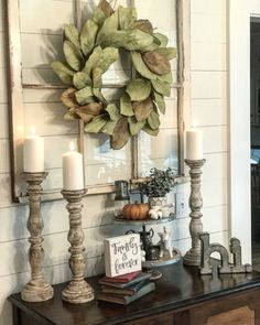 "Thinking of switching out my magnolia wreath on my old window for one like this 😍 and antiquing my pillars like these! AND i already have the ""hi"" metal sign! With plenty of small succulent plants in stone pots! Country Decor, Rustic Decor, Diy Home Decor, Room Decor, Magnolia Wreath, Magnolia Leaves, My New Room, Home Living Room, Entryway Decor"