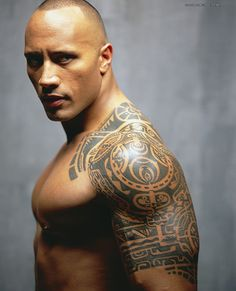 The Rock, The muscular wrestler Rock flaunts his Samoan tattoo having a celtic pattern that looks fearsome.