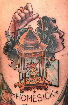 hand and lantern Tattoo by Seth Wood