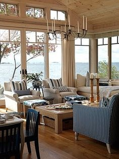 Love the feeling of this living room. bright, airy, blue, white, wood tones