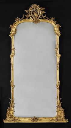 A Very Fine Carved Giltwood Mirror  German, Circa 1780. Mirror, mirror on the wall....