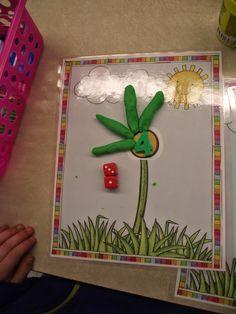 Lancer 2 dés, écrire le nombre obtenu et mettre le bon nombre de pétales sur la fleur