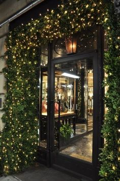 NYC holiday door framed w/ living boxwood