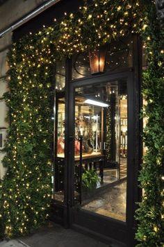 NYC holiday door framed w/ living boxwood