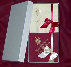 100 Napkin holiday napkin gift set with warm white and cranberry colored napkins, cornucopia design, Florentine Cursive lettering in Antique Satin imprint color