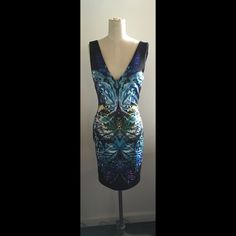 Bebe Bodycon V neck Dress Colorful, slimming, butterfly print on front, black on back. I wear small and this fit perfect bc it hugs the body, stretches and makes you slim. Worn once. bebe Dresses