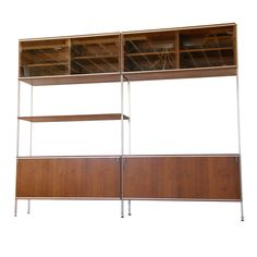 Hugh Acton; Walnut, Aluminum and Glass Storage Unit, 1950s. Hugh did work for American Seating in the 70's, when I met him. I saw him at Art Basel MB with something sculptural a few years back. Can anyone source the manufacturer of this piece?