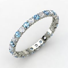 This is the wedding band we like...6 Blue Topaz with Diamonds. 6 Topaz means December 6th -Which is our first date!