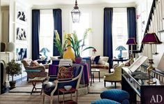 NYC. In a 21st-century emulation of eclectic 19th-century interiors, Bilhuber anchored the living room with a center table and deployed a spirited array of period and contemporary furnishings, including a custom-made pale-green Victorian-style chair and a pair of ottomans upholstered in a blue Muriel Brandolini cotton from Holland & Sherry; the curtains are made of a striped linen by C&C Milano.