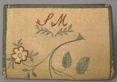 "Pennsylvania silk on linen pocketbook wrought by Sarah Mendenhall, late 18th c., with initials and trailing floral vine, 4 1/2"" w. An early written note discussing this pocketbook accompanies the lot."