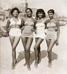 A wide range of fabrics including lined cotton, stretch Lastex and elastic ruched waffle nylon were popular for 1950s swimwear. In this image we can see different types of swim wear such a bikinis and swim corsets. The women's swimwear are accented with halter or strapless necklines, boes and ruching.