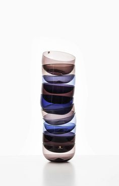 Rare set of 2 large and 11 small glass bowls designed by Timo Sarpaneva. Produced by Iittala in Finland. Available at Studio Schalling