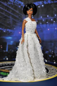 Michelle O - Inaugural Ivory Dress. The dress is embellished with 43 embroidered silver spiders, 320 hand-cut chiffon flowers and 570 Swarovski Crystals.