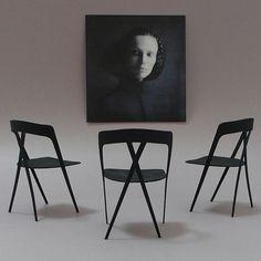 カーボンファイバーを用いた合板の椅子。あまりにも華奢で優美な立ち姿。