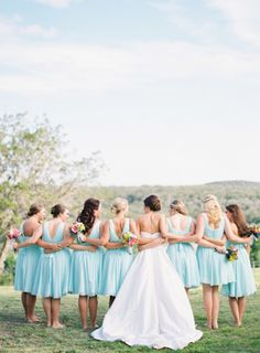 Short mix-and-match chiffon bridesmaid dresses in mint blue. | Photo by: Kayla Barker Fine Art Photography