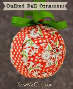 "This DIY ""quilted"" ball ornament makes a great decoration for any time of year. This fun color combination of Riley Blake fabrics is pretty in spring and summer! From sewmccool.com."
