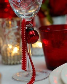 tie a ribbon and small ornament on wine glass... Garden, Home and Party: Table Settings for the season