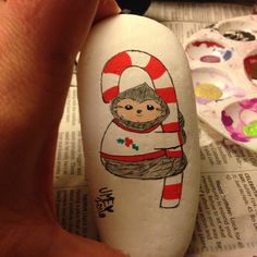 Sloth on a candy cane painted rock