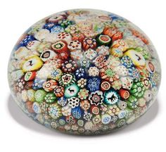 A MILLEFIORI PAPERWEIGHT - probably Baccarat judging by the animal canes visible