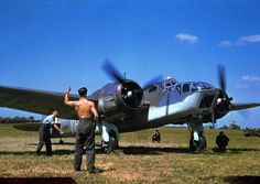 RAF 21Sqn Bristol Blenheim Mk4 V5580/YH-X A mechanic signals for take-off to an Allied pilot before a raid over Occupied France, England, 1941 photo by Robert Cappa