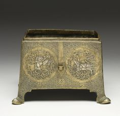 Iranian (Artist)  PERIOD  13th-14th century (Medieval)  MEDIUM  engraved brass, silver inlay	  (Metal)  ACCESSION NUMBER  54.519  MEASUREMENTS  4 1/8 x 6 x 5 1/8 in. (10.5 x 15.3 x 13 cm)  GEOGRAPHIES  Iran (Place of Origin)  This casket features an silver inlaid design of horsemen (possibly falconers) within roundels.