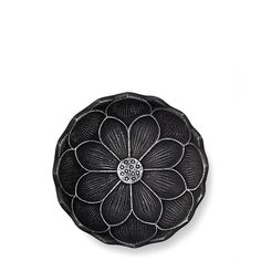 This Teavana cast-iron coaster was designed with intricate detail and pride, a nod to the lotus flower's reverence in Japanese culture as a symbol of purity.