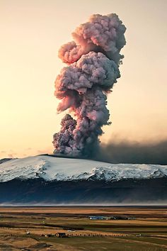 Volcano eruption at sunrise interested by the textural element of the smoke cloud.