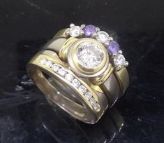 Peter Kumskov 'My Own Jeweller Direct' Brisbane, has created by hand these Diamond Solitaire Two tone Engagement Ring, and Fitted Diamond Wedding Ring. Mum was rewarded on the birth of their gorgeous baby boy with the fitted Diamond and Purple Sapphire Eternity Ring. http://jewellerdirect.com.au/image/data/Gallery/Diamond%20rings/Diamond-Two-tone-Engagement-Fitted-Wedding-and-Eternity-Ring-8web.jpg