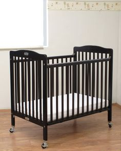 CPSC 16, CFR 1220, ASTM & JPMA certified. Little Wood Compact Folding Crib-Cherry Color